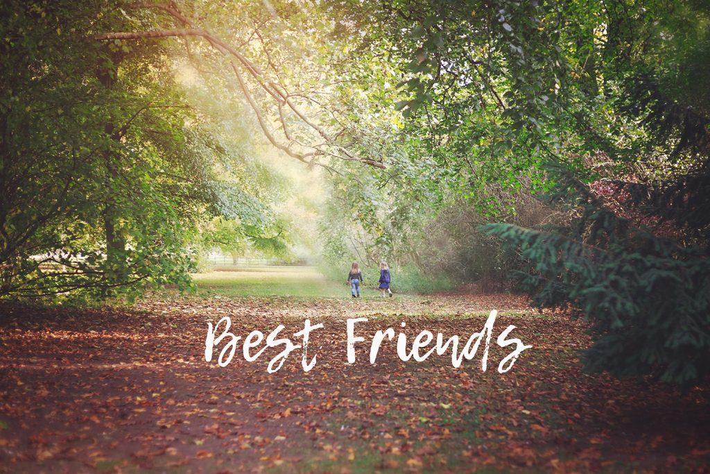 best friends running in woods